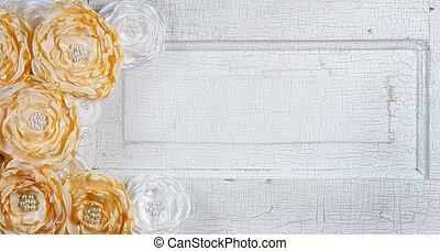 Yellow vintage flowers on door