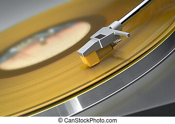Yellow vinyl record on turntable - tilted view