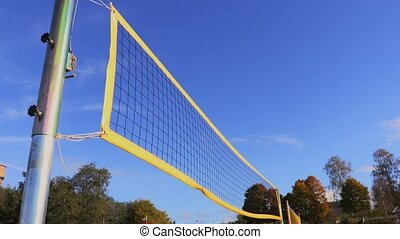 Yellow volleyball net in wind