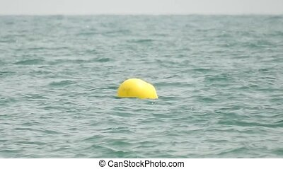 Yellow Water Buoy In Ocean