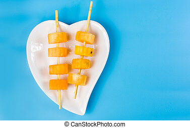 Yellow watermelon kebab on a plate