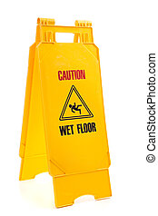 """Yellow wet floor sign - A yellow sign with the words """"..."""