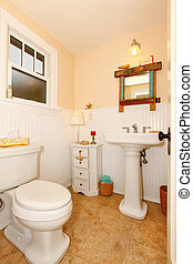 Yellow white powder room