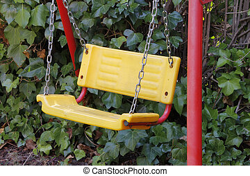 yellow with red legs swing in garden