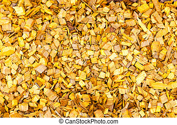 Yellow wood chips as creative background