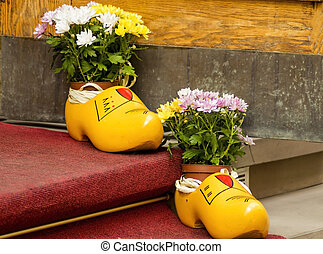 yellow wooden shoes as a decor element.