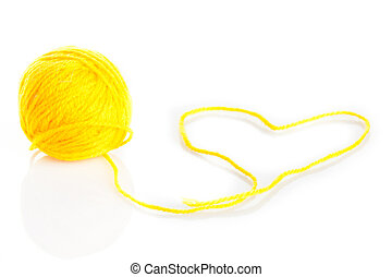 Yellow wool yarn ball isolated on white background
