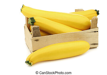 yellow  zucchini's in a wooden crate