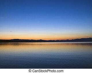 Yellowstone Lake Dawn - Dawn breaks at Yellowstone Lake, ...