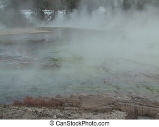 Yellowstone - Steam flowing over Yellowstone National Park...