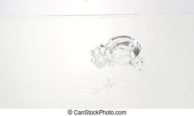 Yelow Pepper splashing into water in slowmotion