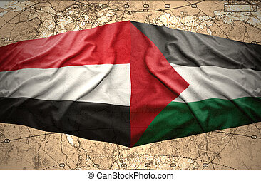 Yemen and Palestine - Waving Yemeni and Palestinian flags on...