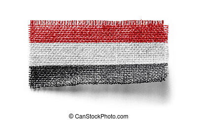 Yemen flag on a piece of cloth on a white background