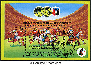 YEMEN PDR - CIRCA 1990: A stamp printed in Yemen PDR shows Soccer game, History of World Football Championships, circa 1990