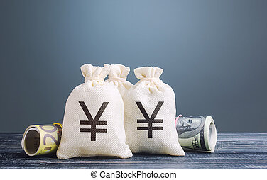 Yen yuan money bags. Capital investment, savings. Economics, lending business. Profit income, dividends payouts. Crowdfunding startups investing. Banking service, monetary policy. Reserve currency