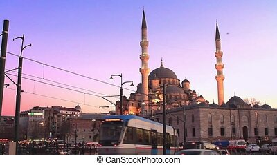 Yeni Mosque calls Muslims for evening pray at Eminonu Square in Istanbul, Turkey.