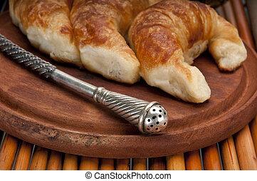 Yerba mate straw and croissants