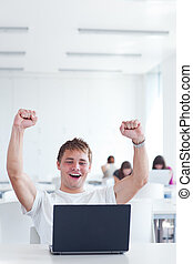 Yes! - happy young male college student, rejoicing over his...