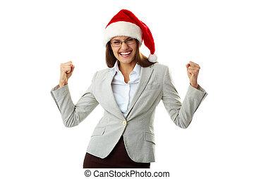 Yes! - Portrait of ecstatic businesswoman in Santa cap...