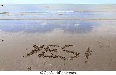 YES written on the beach