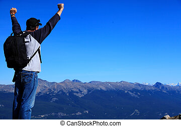 yhiker on mountain range feeling joy and victory - hiker...