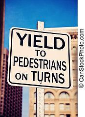 Yield on pedestrians on turns sing in the center of Boston, Massachusetts