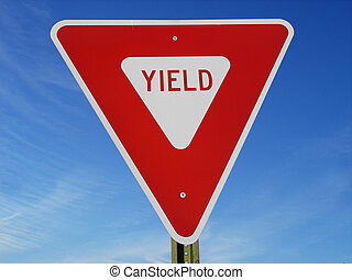 Yield Sign - Yield sign against blue sky.