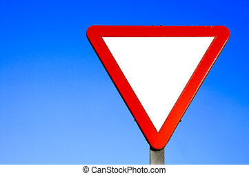 Yield / Give way sign on a blue sky