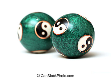 Ying Yang Balls, isolated on white background. Focus on a...