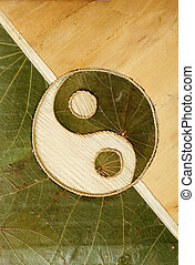 Ying-Yang symbol in dried leaves