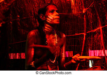 Yirrganydji Aboriginal woman play Aboriginal music with...