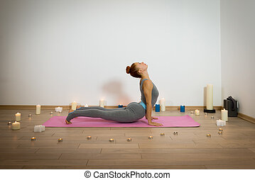 Yoga among candles