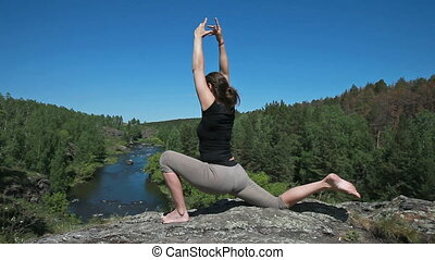 Yoga and nature - Yoga girl holding balance doing various...