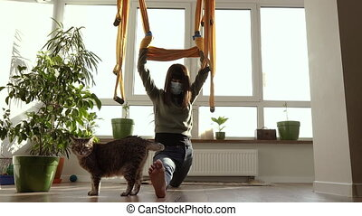 Yoga at home. A woman during a pandemic virus does exercises at home.