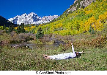 Yoga at Maroon Bells - a woman practicing yoga at maroon...