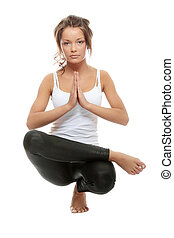 Yoga - Beautiful young woman doing yoga exercise isolated