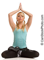 yoga - blond woman in lotos pose on a white background
