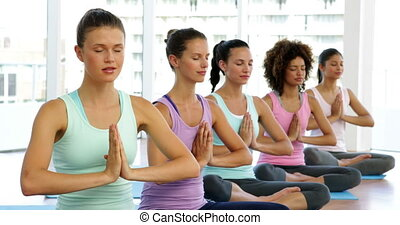 Yoga class in fitness studio at the gym
