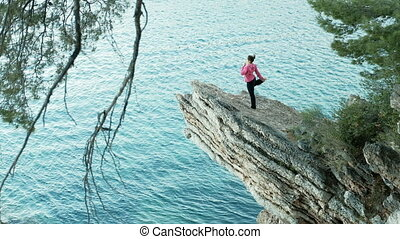 Yoga coach Stunning views of the cliff and a woman who is...