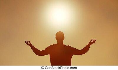 Yoga concept. Yogi under bright sun