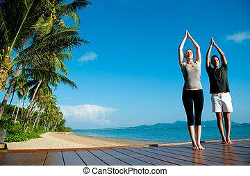 Yoga Couple By Ocean