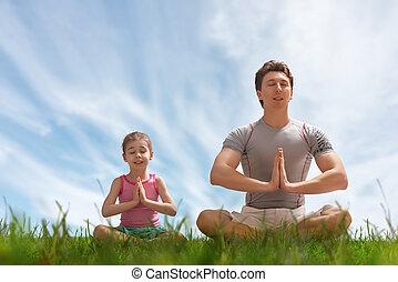 yoga, en la hierba