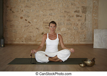 Yoga excercise indoor in a room