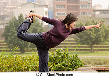 Yoga excise of Asian woman in outdoor of park in city.