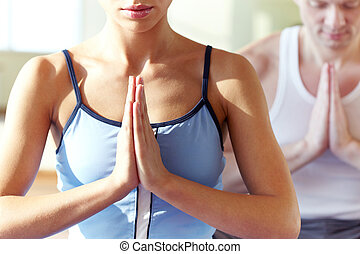 Yoga exercise - Photo of meditating girl with hands kept in...