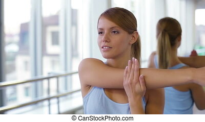 Yoga Exercises - Close-shot of a peaceful young woman doing...