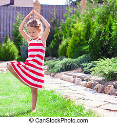 Yoga girl on green grass in the morning