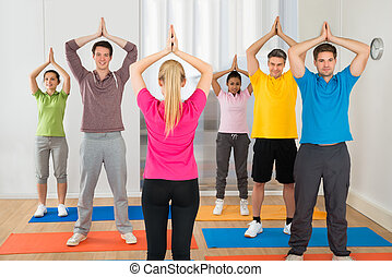 Yoga Instructor And Students