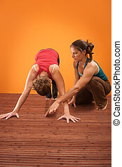 Yoga Instructor Helps Her Student