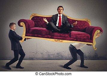 Yoga man on sofa - Men carrying a yoga businessman on sofa